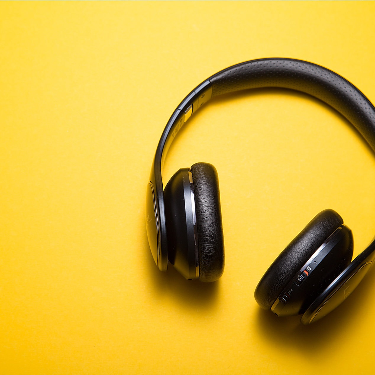 Black headphones on a yellow background
