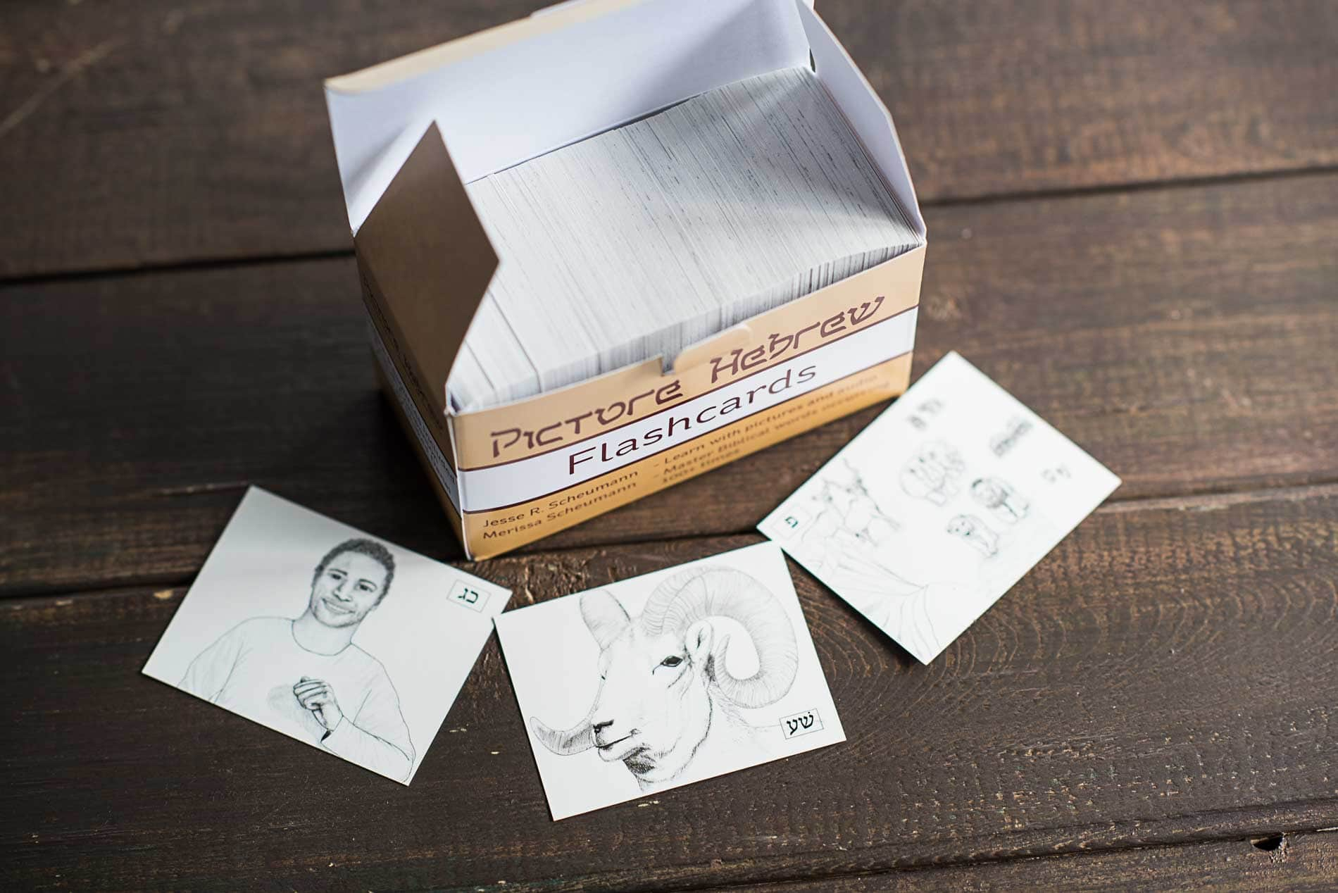 Picture Hebrew Flashcards Open Box with Illustrations on wooden table
